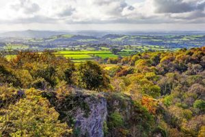 ebbor gorge view from ebbor rock of the somerset levels and glastonbury tor in the mist with a